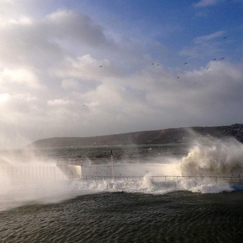Wave breaching Jubilee Pool wall