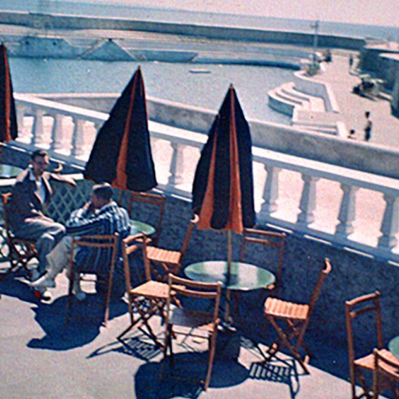 Men on café terrace and Jubilee Pool