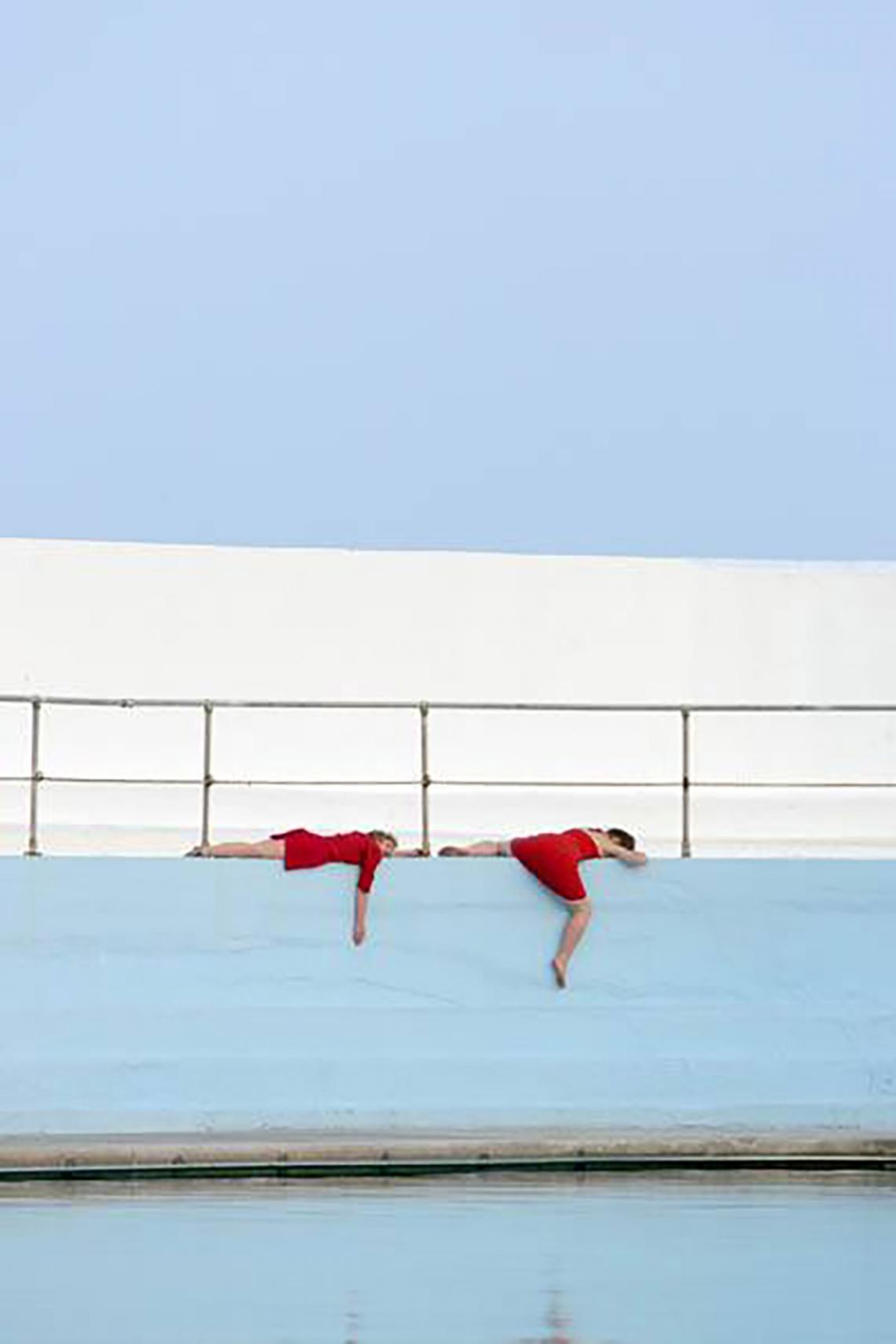 Live art at the pool - red performers 2