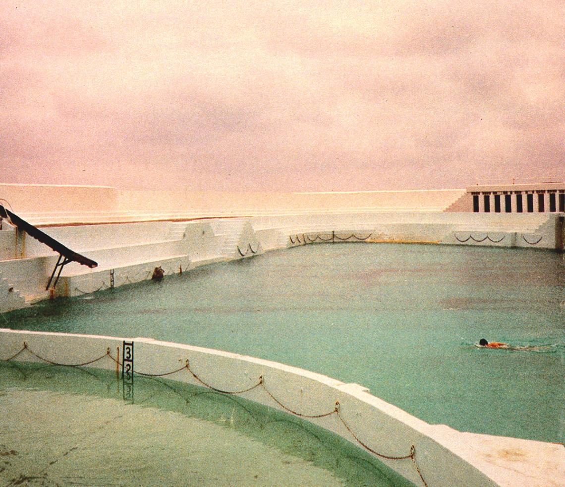 Single swimmer crosses the pool