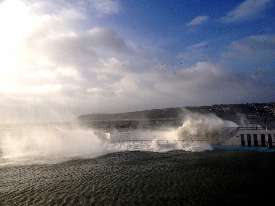 Wave breaching Jubilee Pool wall