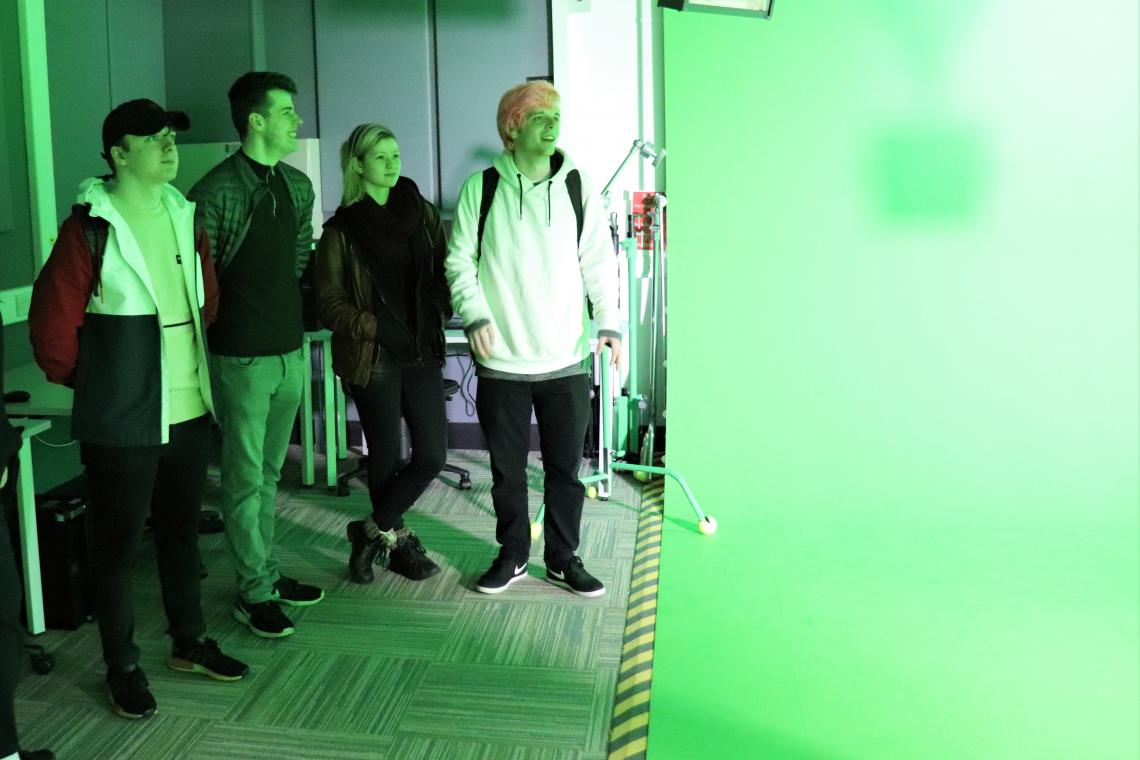 Penwith College Media Diploma students looking round Falmouth University School of Film and TV in a green screen studio