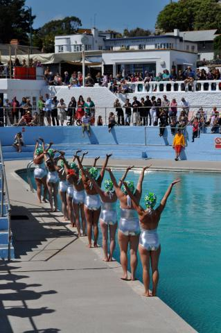 Synchronised swimmers prepare to dive at Art75