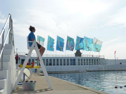 Flags at Jubilee Pool and lifeguard