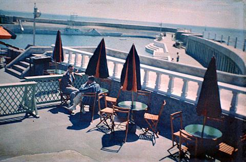 Men on café terrace and Jubilee Pool