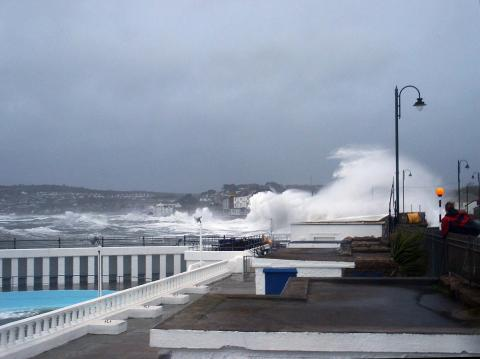 Waves crash over Penzance Promenade