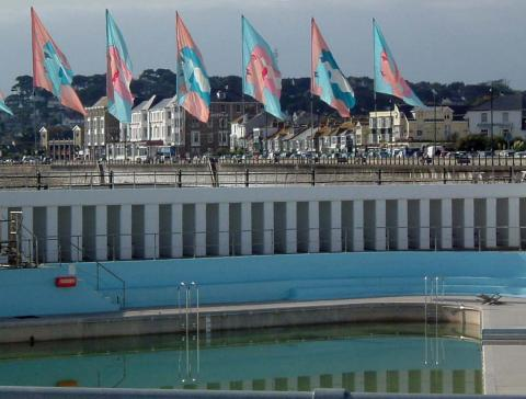 Jubilee Pool and promenade with flags