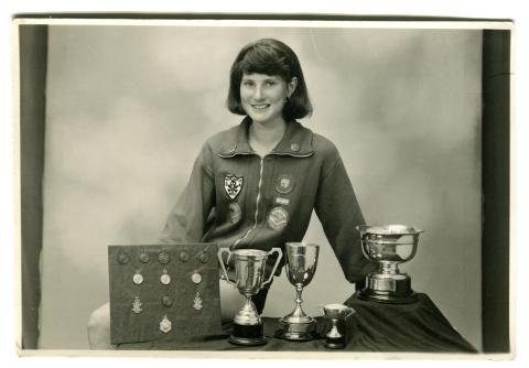 Ruth Trevenen with swimming cups and medals